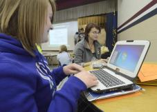 Logging on: Riverton-Parke juniors Catie Butler and Browdie Boillard fire up their new laptop computers Wednesday morning. (Tribune-Star/Jim Avelis)