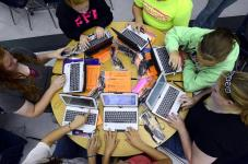 Tribune-Star/Jim Avelis Fired up: A table full of Riverton-Parke juniors log on to their new laptop computers Wednesday afternoon.
