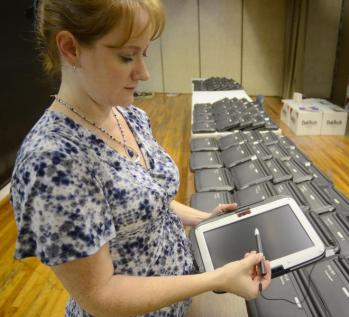Tribune-Star/Jim Avelis Convertible: Riverton-Parke's Rachel Porter demonstrates the versatility of the new laptops the students will be using this school year.